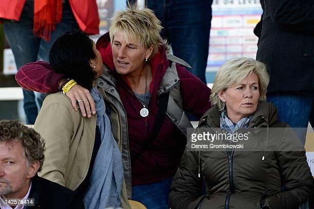 Goalkeeper coach of the german women's national football team Silke Rottenberg greets Steffi Jones during the Women's DFB Cup semi final match...