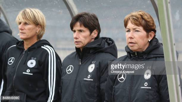 Goalkeeper coach Silke Rottenberg assistant coach Bettina Weidmann and head coach Maren Meinert of Germany sing the national anthem during the UEFA...