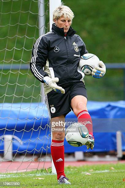 Goalkeeper coach Silke Rottenberg of Germany shoots the ball prior to the U17 International friendly match between Germany and Netherlands at...