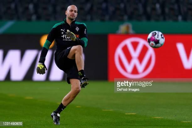 Goalkeeper coach Steffen Krebs of Borussia Moenchengladbach controls the ball during the DFB Cup quarter final match between Borussia Mönchengladbach...