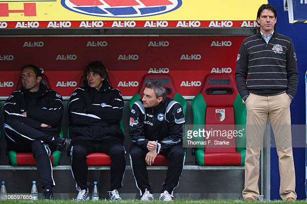 Goalkeeper coach Thomas Schlieck assistant coaches Ralf Santelli and Mario Himsl and head coach Christian Ziege of Bielefeld look on during the...