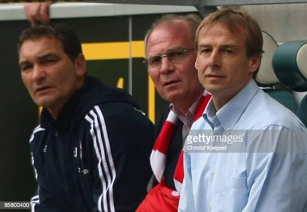 Goalkeeper coach Walter Junghans manager Uli Hoeness and head coach Juergen Klinsmann of Bayern look on during the Bundesliga match between VfL...