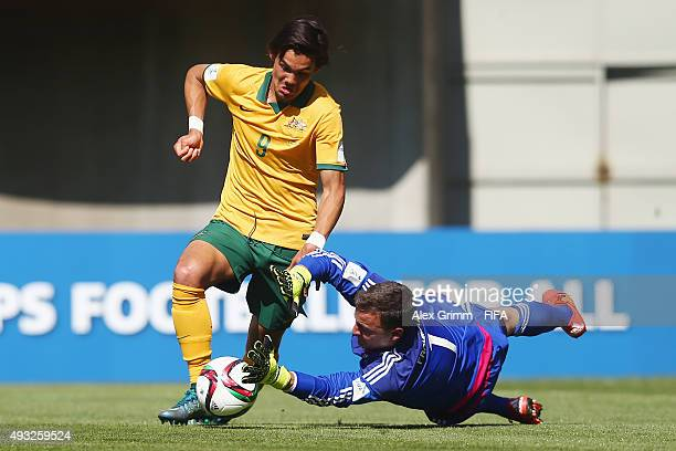 Goalkeeper Constantin Frommann of Germany makes a save against Pierce Waring of Australia during the FIFA U17 World Cup Chile 2015 Group C match...