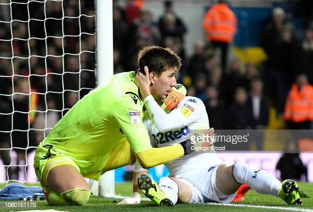 Goalkeeper Costel Pantilimon of Nottingham Forest hugs Ezgjan Alioski of Leeds United after Alioski misses a chance on goal during the Sky Bet...