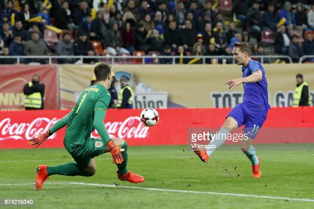 goalkeeper Costel Pantilimon of Romania Luuk de Jong of Holland during the friendly match between Romania and The Netherlands on November 14 2017 at...