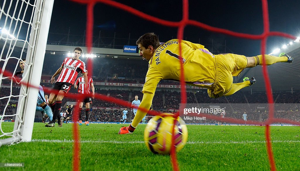Goalkeeper Costel Pantilimon #1 of Sunderland is beaten as Sergio Aguero (L- obscured) of Manchester City scores his team's fourth goal during the Barclays Premier League match between Sunderland and Manchester City at The Stadium of Light on December 3, 2014 in Sunderland, England.