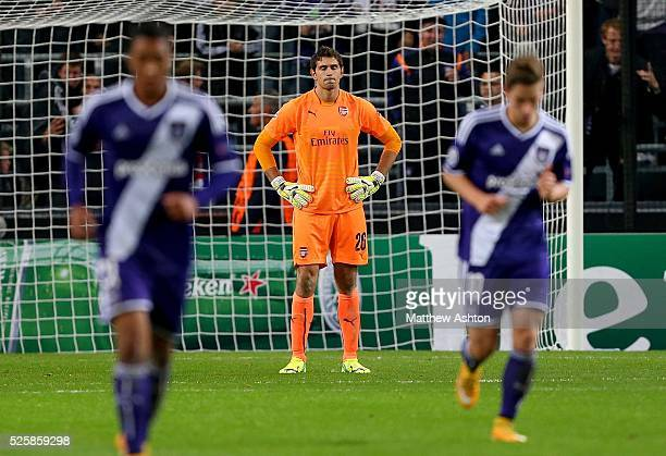 Goalkeeper Damian Martinez of Arsenal stands dejected after Anderlecht go 1-0 up
