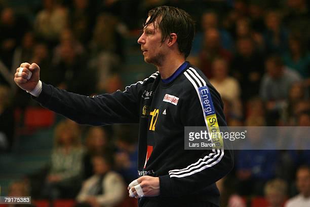 Goalkeeper Dan Beutler of Sweden celebrates after a good save during the Men's Handball European Championship main round Group II match between Spain...