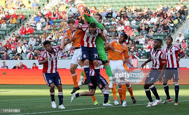 Goalkeeper Dan Kennedy of Chivas USA punches the corner kick clear of goal in the second half during their MLS match against the Houston Dynamo at...