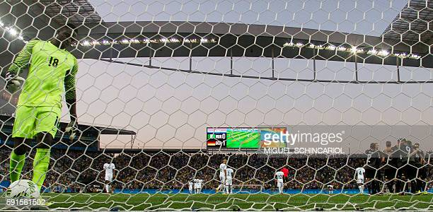 Goalkeeper Daniel Akpeyi of Nigeria fails to save a goal from Nils Petersen of Germany during their Rio 2016 Olympic Games men's football semifinal...