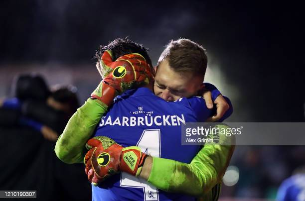 Goalkeeper Daniel Batz of Saarbruecken celebrates with team mate Christopher Schorch after saving a penalty from Mathias Zanka Jørgensen of Fortuna...