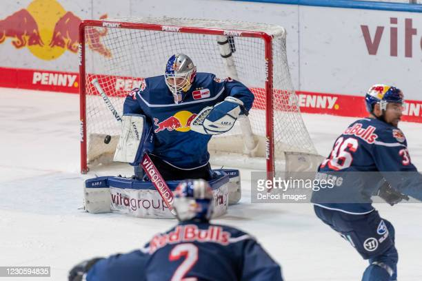 Goalkeeper Daniel Fiessinger of EHC Red Bull Muenchen at AEV's 4:2 goal during the DEL match between EHC Red Bull Muenchen and Augsburger Panther on...