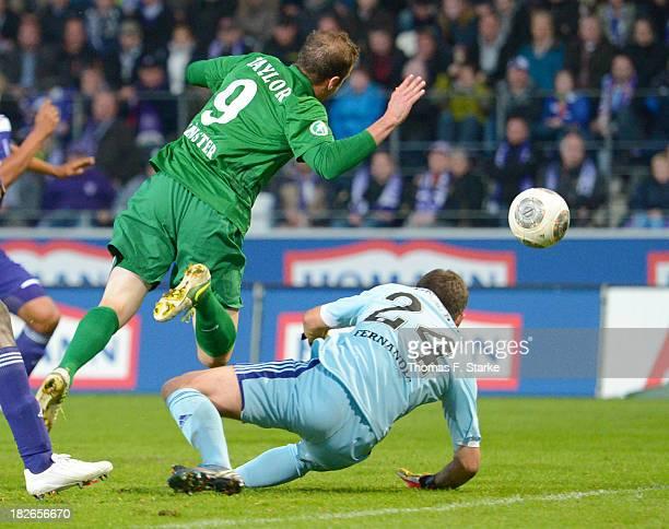 Goalkeeper Daniel Heuer Fernandes of Osnabrueck tackles Matthew Taylor of Muenster during the Third League match between between VfL Osnabrueck and...