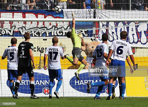Goalkeeper Daniel Ischdonat of Sandhausen saves a shot during a German third Bundesliga match between 1.FC Heidenheim and SV Sandhausen on August 21,...