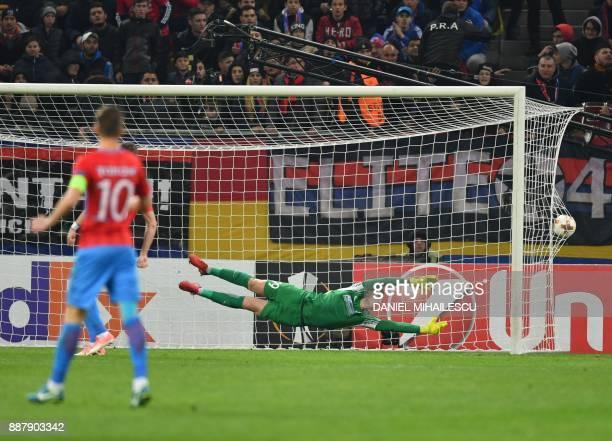 Goalkeeper Daniel Vlad of Steaua Bucharest fails to fend off a goal by Fabio Daprela of Energy Investment Lugano during the UEFA Europa League group...