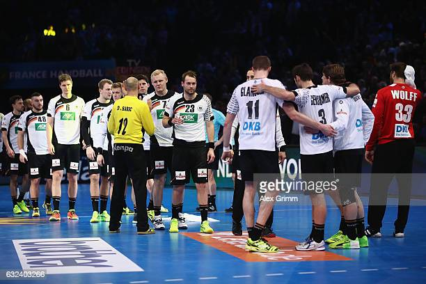 Goalkeeper Danijel Saric of Qatar shakes hands with the players of the German team after the 25th IHF Men's World Championship 2017 Round of 16 match...