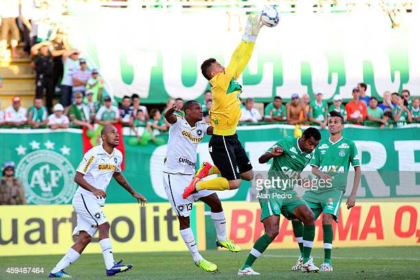 Goalkeeper Danilo of Chapecoense struggles for the ball with a Andre Bahia of XXXXXXXXXX during a match between Chapecoense and Botafogo for the...