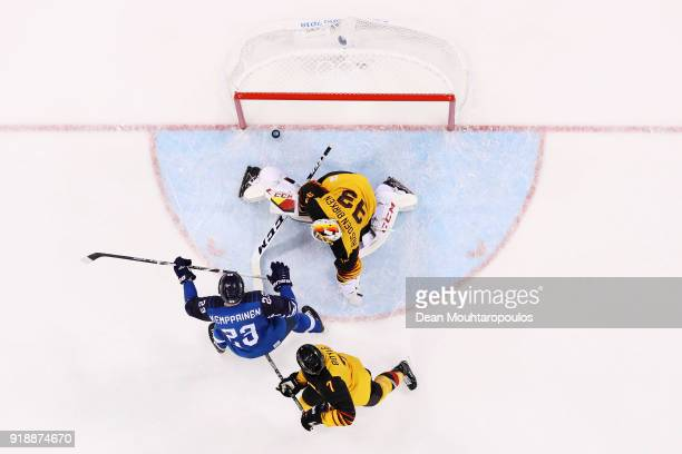 Goalkeeper Danny aus den Birken of Germany fails to make the save from Joonas Kemppainen of Finland during the Men's Ice Hockey Preliminary Round...