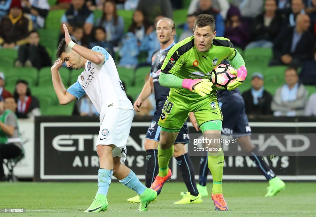 Goalkeeper Danny Vukovic of Sydney FC makes a save as Bruno Fornaroli of City competes for the ball during the round 21 A-League match between Melbourne City and Sydney FC at AAMI Park on February 24, 2017 in Melbourne, Australia.