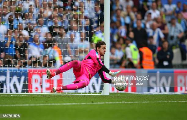 Goalkeeper Danny Ward of Huddersfield Town saves a penalty during the shootout during the Sky Bet Championship Play Off Final match between Reading...