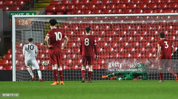 Goalkeeper Danny Ward of Liverpool is sent the wrong way as Callum Gribbin of Manchester United scores from the penalty spot during the Premier...