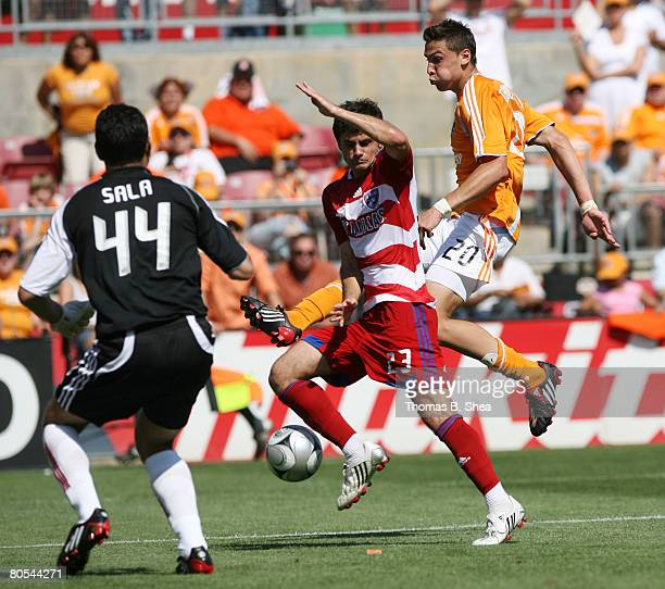 Goalkeeper Dario Sala and Blake Wagner of FC Dallas defend against Geoff Cameron of the Houston Dynamo during an MLS game at Robertson Stadium April...