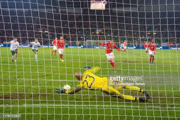 Goalkeeper Darren Randolph of Republic of Ireland makes a save from penalty kick of Ricardo Rodriguez of Switzerland during the UEFA Euro 2020...