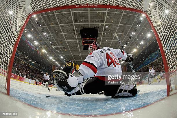Goalkeeper David Aebischer of Switzerland fails to stop Germany's first goal by Sven Felski Germany during the second period men's ice hockey...