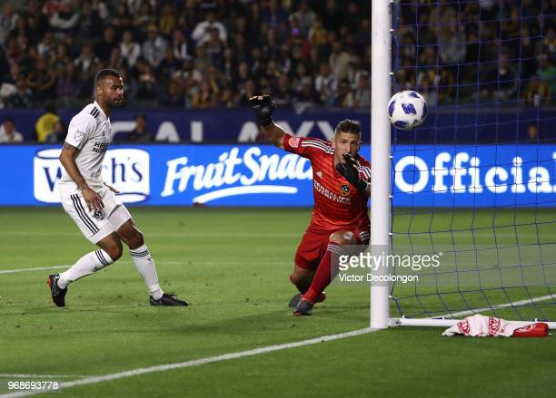 Goalkeeper David Bingham and defender Ashley Cole of Los Angeles Galaxy watch as the ball goes wide of the goal in the first half during the MLS...
