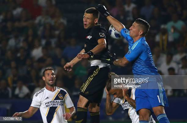 Goalkeeper David Bingham of Los Angeles Galaxy punches at the ball as Christian Ramirez of Los Angeles FC tries for the header during the first half...