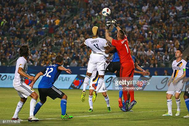 Goalkeeper David Bingham of the San Jose Earthquakes punches the ball away from Gyasi Zardes of the Los Angeles Galaxy during the first half of their...