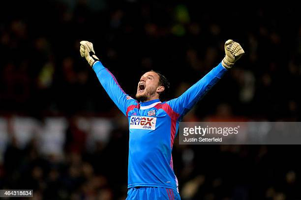 Goalkeeper David Button of Brentford celebrates as his team score the opening goal during the Sky Bet Championship match between Brentford and...