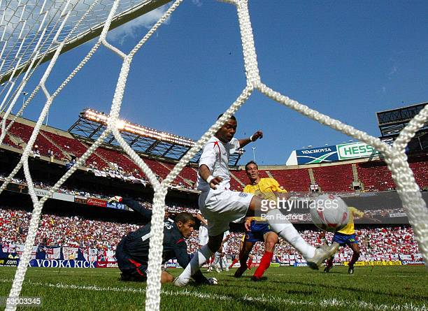 Goalkeeper David James Joe Cole of England watch as the ball go into the net on a shot by Mario Yepes of Colombia during the game at Giants Stadium...