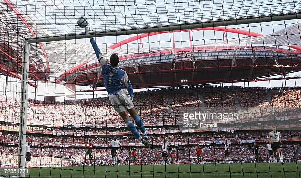 Goalkeeper David James of England tips the ball over the bar during the UEFA Euro 2004 Quarter Final match between Portugal and England at the Luz...