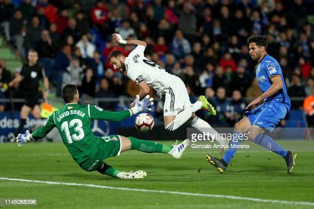 goalkeeper David Soria of Getafe CF blocks Karim Benzema of Real Madrid CF during the La Liga match between Getafe CF and Real Madrid CF at Coliseum...