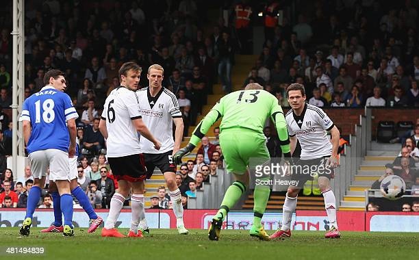 Goalkeeper David Stockdale of Fulham fails to stop a shot by Steven Naismith of Everton for the opening goal during the Barclays Premier League match...