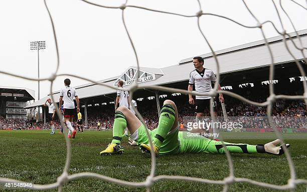 Goalkeeper David Stockdale of Fulham lies on the ground after his own goal during the Barclays Premier League match between Fulham and Everton at...