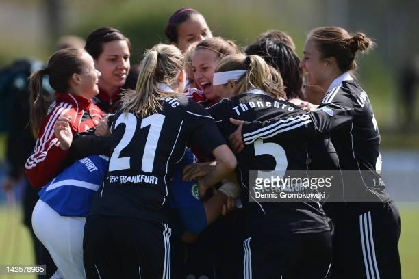 Goalkeeper Desiree Schumann of Frankfurt celebrates with teammates after the Women's DFB Cup semi final match between 1. FFC Frankfurt and FCR...