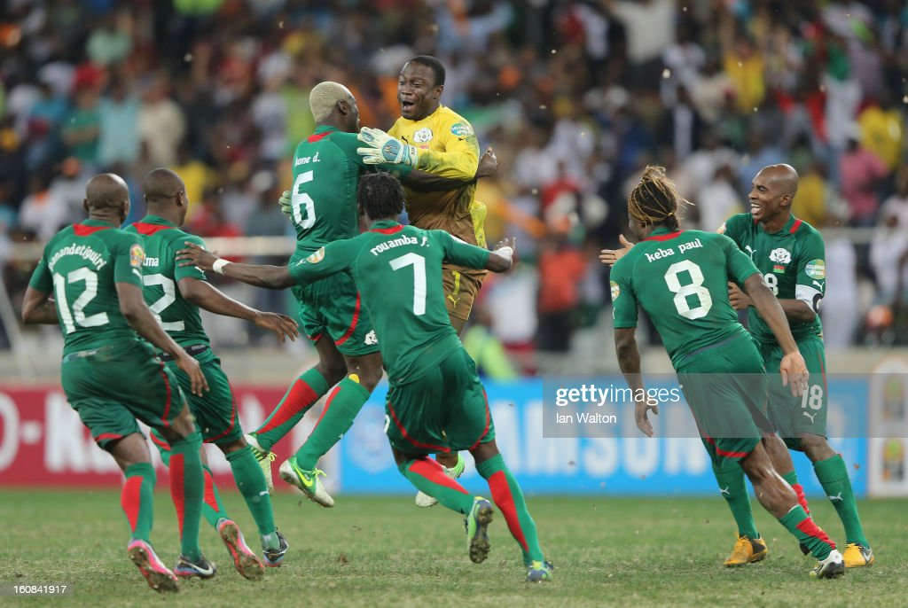 Goalkeeper Diakite Daouda (3rd R) of Burkina Faso celebrates victory with team-mates after saving a penalty in a shootout during the 2013 Africa Cup of Nations Semi-Final match between Burkina Faso and Ghana at the Mbombela Stadium on February 6, 2013 in Nelspruit, South Africa.