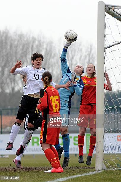 Goalkeeper Diede Lemey of Belgium tips the ball over the bar under pressure from Jasmin Sehan of Germany during the U17 Girls Tournament match...