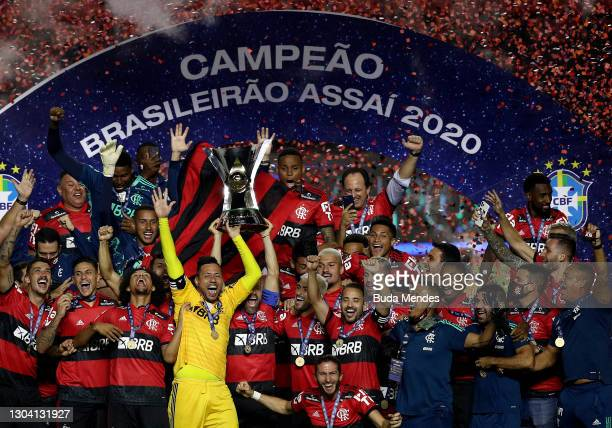 Goalkeeper Diego Alves and Diego of Flamengo lift the champions trophy after a match between Sao Paulo and Flamengo as part of 2020 Brasileirao...