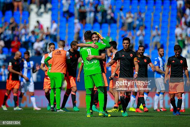 Goalkeeper Diego Alves of Valencia CF celebrates their victory with teammate Dani Parejo after the La Liga match between CD Leganes and Valencia CF...