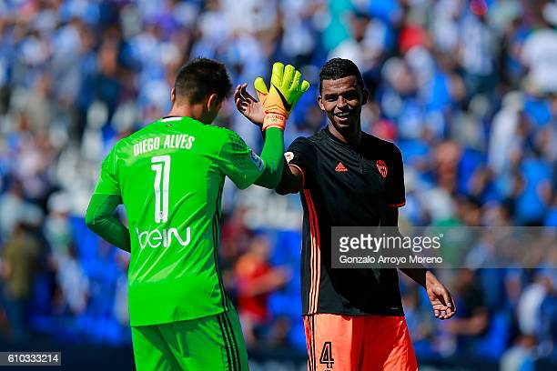Goalkeeper Diego Alves of Valencia CF celebrates their victory with teammate Aderllan Santos after the La Liga match between CD Leganes and Valencia...