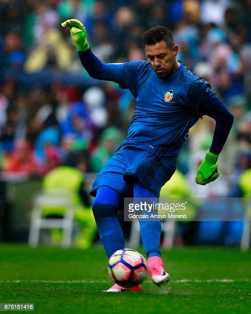 Goalkeeper Diego Alves of Valencia CF strikes the ball during the La Liga match between Real Madrid CF and Valencia CF at Estadio Santiago Bernabeu...