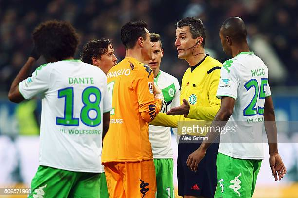 Goalkeeper Diego Benaglio and team mates of Wolfsburg discuss with referee Knut Kircher after Alexander Meier of Frankfurt has scored his team's...