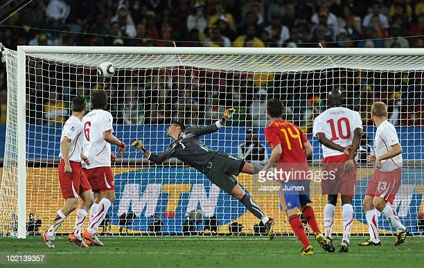 Goalkeeper Diego Benaglio of Switzerland watches the long range shot by Xabi Alonso of Spain hit the cross bar during the 2010 FIFA World Cup South...