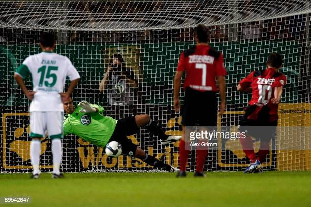 Goalkeeper Diego Benaglio of Wolfsburg saves a penalty of Marcel Ziemer of WehenWiesbaden during the DFB Cup first round match between SV...