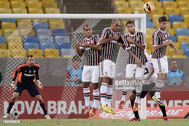 Goalkeeper Diego Cavalieri Felipe Leandro Eusebio Gum and Rafael Sobis of Fluminense in action during a match between Fluminense and Vitoria as part...
