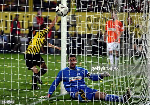 Goalkeeper Dimo Wache of Mainz sits dejected on the ground after Szilard Nemeth of Aachen scored the first goal during the Second Bundesliga match...