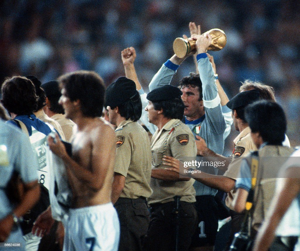 Goalkeeper Dino Zoff of Italy celebrate with trophy and the team after the World Cup final match between Italy and Germany on July 11, 1982 in Madrid, Spain.